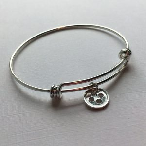 Adjustable sterling silver bangle with little button charms