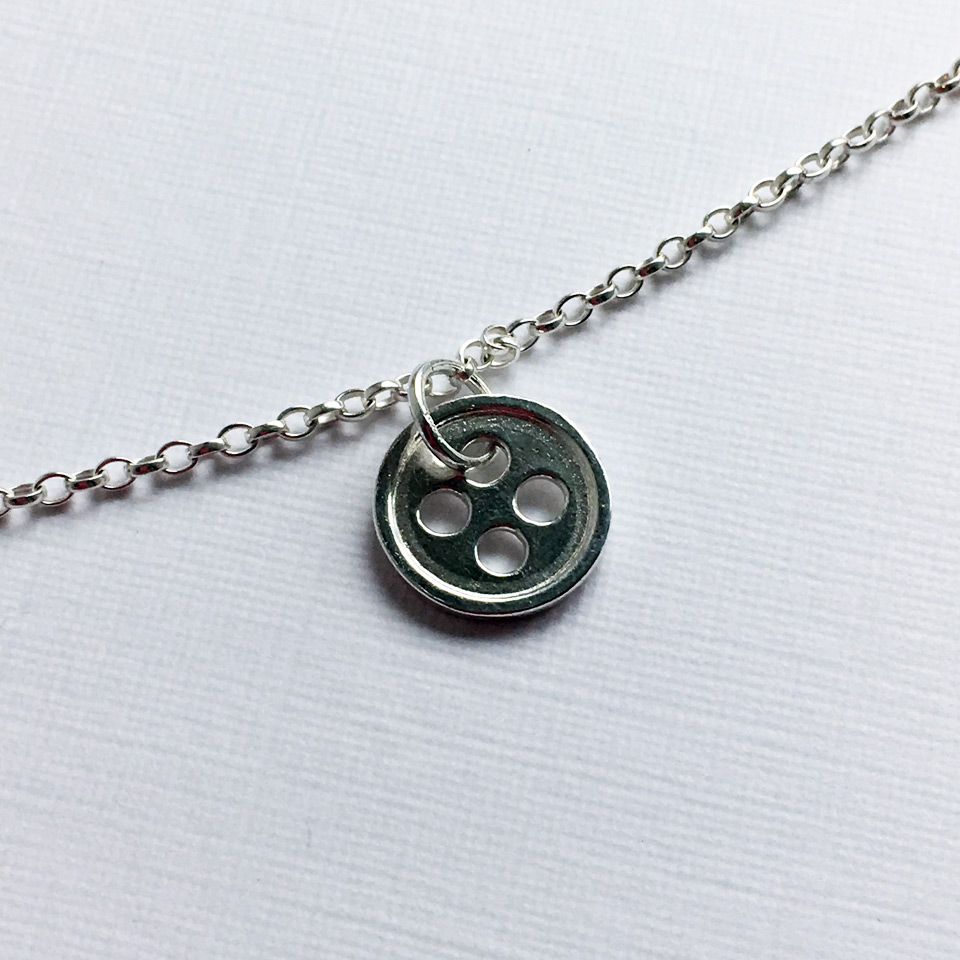 Our Little Button sterling silver necklace with one button