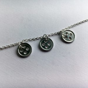Our Little Button sterling silver necklace with three button charms