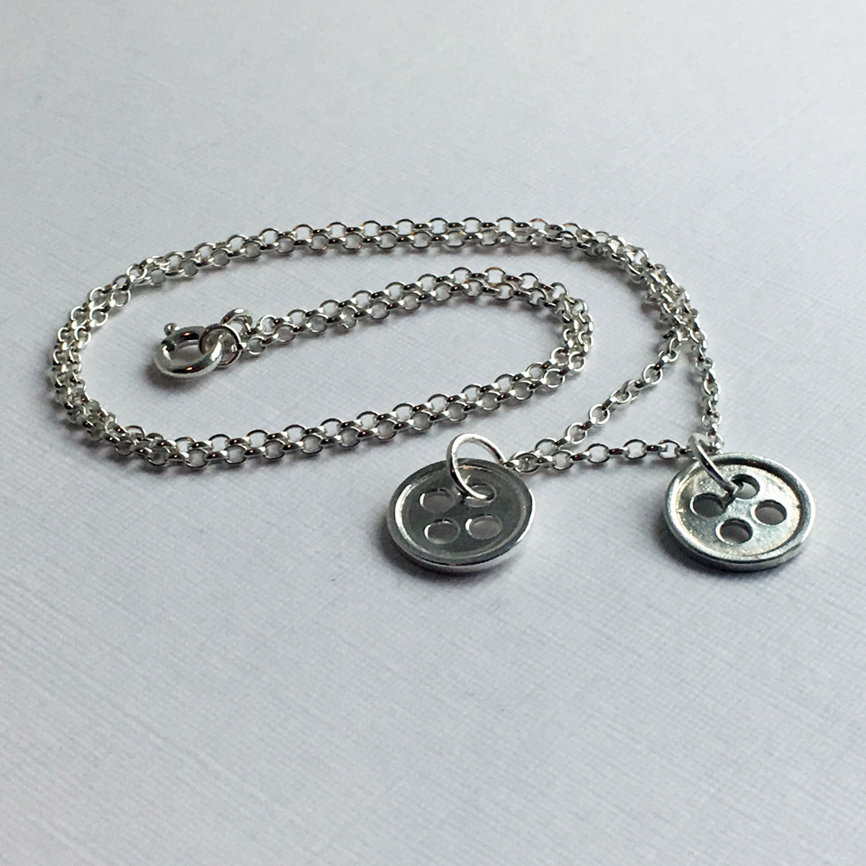 Our Little Button sterling silver necklace with two button charms